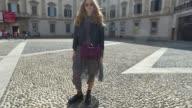 Olja Ryzevsci wearing Lala Berlin dress Dr Martens shoes Aigner bag and Ganni jacket is seen during Milan Fashion Week Spring/Summer 2018 on...