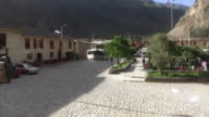 Ollantaytambo, Peru, Town Square and Tourist Bus