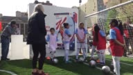 Olympic athlete event sponsored by Kellogg's at Union Square USA Women's Soccer team member Julie Johnston demonstrates soccer drills with youth...