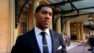 Olympic gold medal winning boxer Anthony Joshua honoured Buckingham Palace EXT Joshua interview SOT