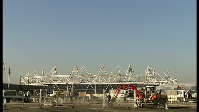Olympic Park under construction / Mayor of Newham interview GV Olympic Stadium with digger in foreground / London Aquatics centre with cranes behind...