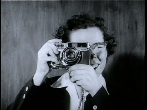 Olympic skater Cornelia Pooch Harrington takes a picture with a camera
