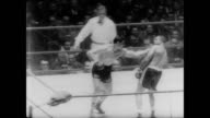 Olympic Sports Palace in Rome / boxing match before large crowd / Archie Moore of America fights Giulio Rinaldi in a no title fight / Moore is tiring...