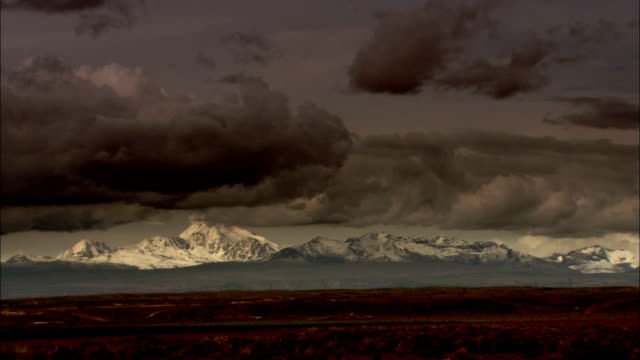 Ominous storm clouds hang low over Bolivian mountains. Available in HD.
