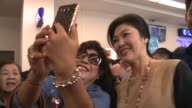 On a fighting with smiles tour by ex premier Yingluck Shinawatra selfies and symbols are the weapons of choice showing adoring fans her family are...