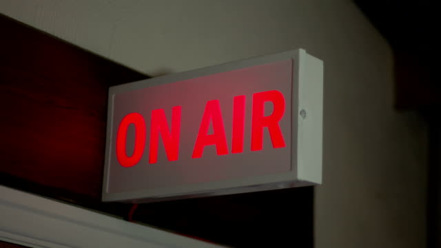 On Air sign lighting up in TV Studio, Radio Station