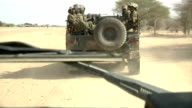 on an army truck riding through Kenyan border with Somalia Kenyan soldiers on July 31 2011 in Liboi Kenya