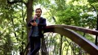 On bridge in park