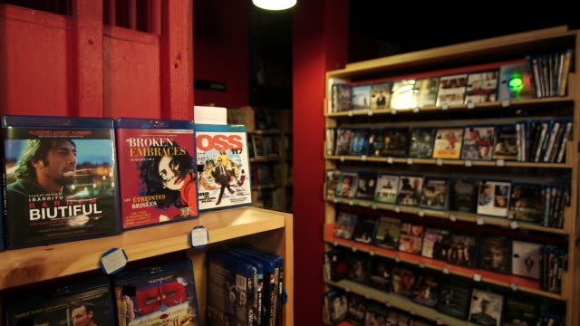 IN on international DVD and Bluray cases on shelves Films go out of focus NO