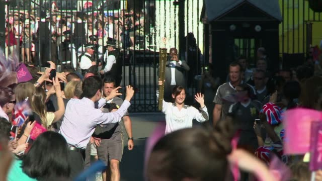On its journey through central London Friday the Olympic torch passed through Piccadilly Circus before entering Downing Street for an audience with...