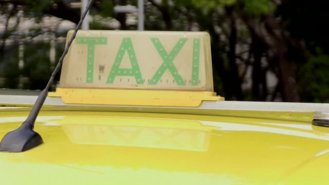 On opposite sides of Brasilia's Congress Uber and Taxi drivers protested Tuesday ahead of a key vote that might set new rules for online based taxi...