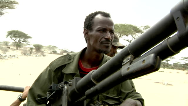 on the back of a pickup truck Somali Militia man and machine gun on July 31 2011 in Dhoobley Somalia