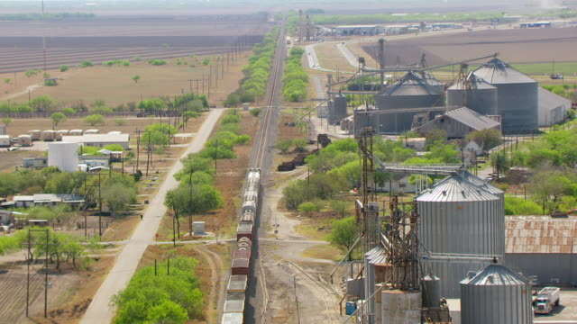 MS AERIAL ZI on train rolling into town in South Texas Plains en route from San Antonio to Kingsville / Texas, United States