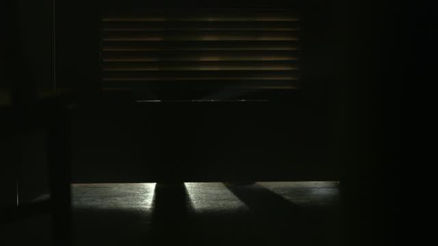 POV on unsettling person behind dark door