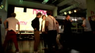 'One Direction' boy band meet fans ENGLAND London HMV PHOTOGRAPHY** Vairous shots of One Direction band members onto stage and greeting screaming...