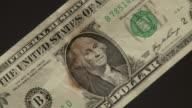CU U.S. one dollar bill starts to burn up
