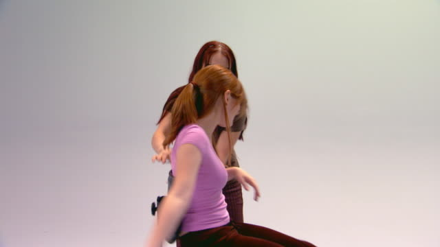 one girl spinning a friend on a chair