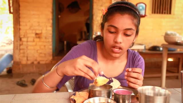 One Indian teenager girl enjoying her Konkani Food Meal