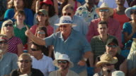 HA MS One man in diverse crowd jumping up and cheering in bleachers / Homestead, FL, USA