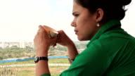 One sad female drinking coffee outdoor