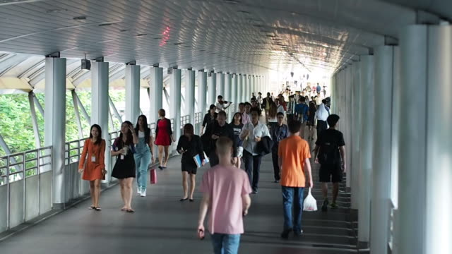 One side of commuters cross bridge to take the skytrain.