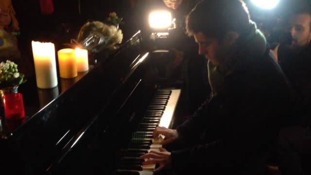 One week after the terrorist attacks that made 130 dead and 350 injured a man plays piano in front of the 'Bataclan' concert hall in memory of the...