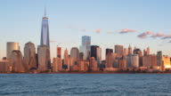 One World Trade Center and Downtown Manhattan day to night Time lapse viewed across the Hudson River, New York, Manhattan, United States of America