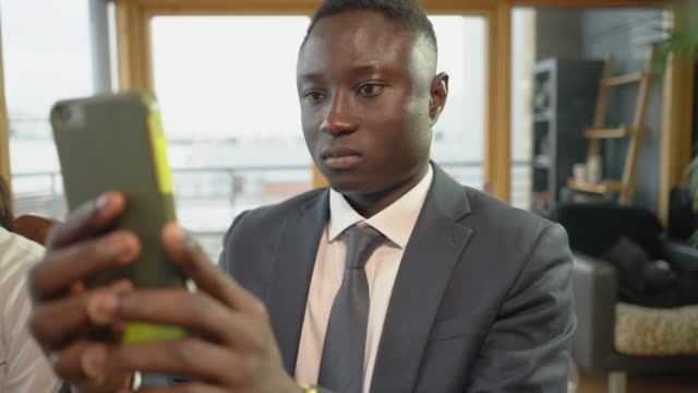 One young man in a suit making a selfie.