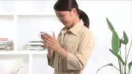 One young woman is drinking a cup of coffee