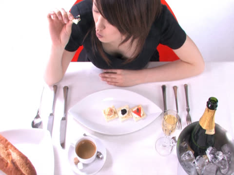 One young woman is having a meal