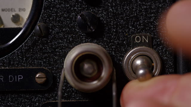 On-off switch is flipped on old shortwave radio