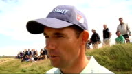 preview ENGLAND Lancashire Royal Birkdale EXT Padraig Harrington along on fairway and interview SOT On wrist injury practice round strong wind Sergio...