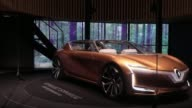 Open doors reveal the interior seating 'room' area inside a Renault SA Symbioz electric concept car during the second media preview day of the IAA...