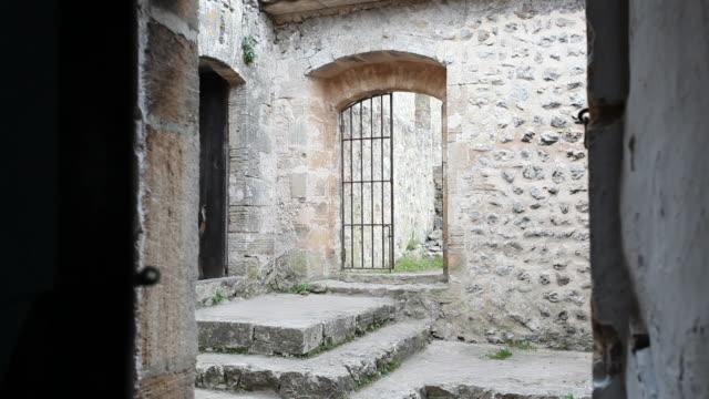 opening a door in an old monastery