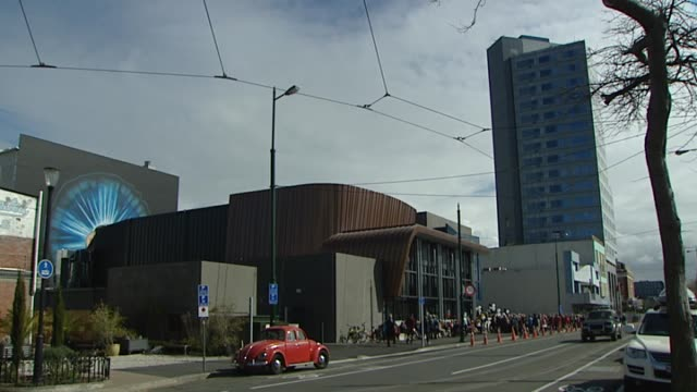 Opening day at The Piano music performing arts centre after former facility was destroyed in 2011 earthquake with people queuing to enter building...
