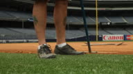 Opening outfield gate to empty Yankee Stadium baseball field ballpark seats no visible people NY Yankees Yanks Bronx Bombers MLB Major League...