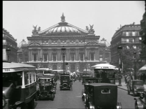 B/W 1927 Opera Garnier with traffic + people in Place de l'Opera in foreground / Paris, France