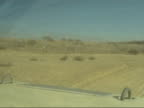 Nr Husaybah EXT Convoy of US military vehicles along thru desert TRACK FORWARD Armoured truck stopped in desert US marines investigating antitank...