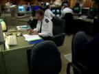 Operators monitor CCTV in a police control centre UK 2000