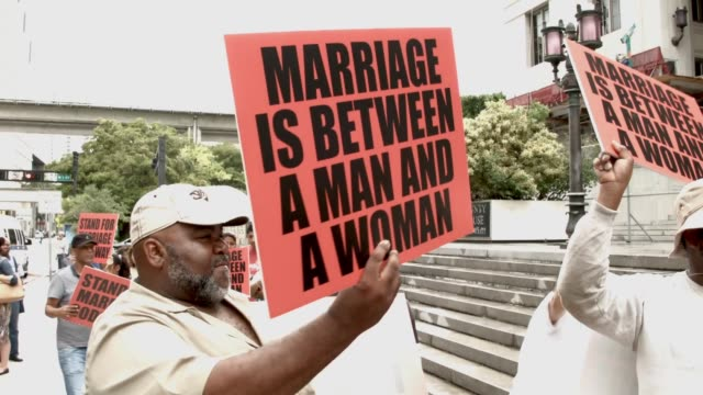 MS Opponents of samesex marriage stand near supporters of the LGBTQ couples who are inside the courthouse asking the state of Florida to recognize...