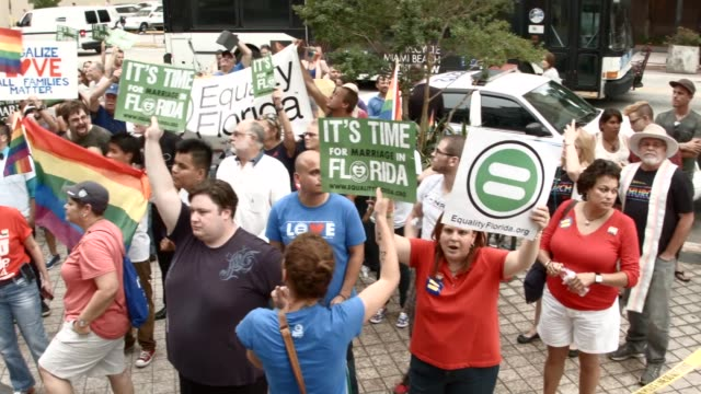 PAN Opponents of samesex marriage stand near supporters of the LGBTQ couples who are inside the courthouse asking the state of Florida to recognize...