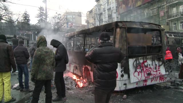 Opposition protesters were Monday locked in a tense standoff with Ukrainian police in Kiev after bloody clashes that wounded over 200 people as...