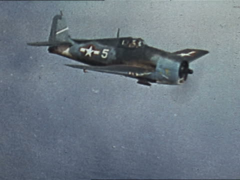 1943 or 1944 WWII F6F Hellcat flying over Pacific