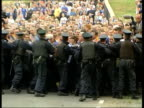 Portadown EXT Orange Order marchers along Orange Order members gathered outside Drumcree Church CMS Ditto Orange Order members confronting line of...
