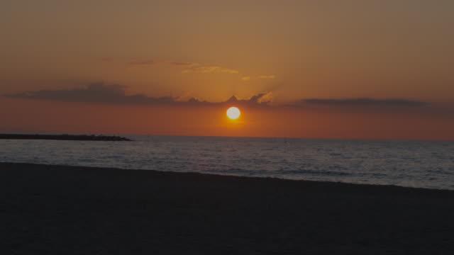 Orange Sunrise at Spanish beach