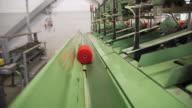 WS Orange thread on conveyor belt in Camira Fabrics Moquette Factory / Lithuania