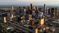 Orbiting downtown Houston in afternoon light, freeway in foreground. Shot in 2007.