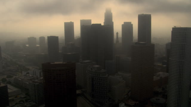 Orbiting downtown Los Angeles with smog and overcast skies. Shot in 2008.