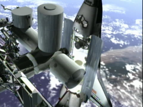 Orbiting Space Shuttle and Space Station joining