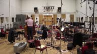 Orchestral musicians preparing to record at London's iconic Abbey Road Studios made famous by the likes of the Beatles NO